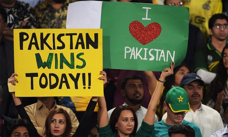 Lahore fans express their delight at cricket's return to Pakistan. ─ AFP