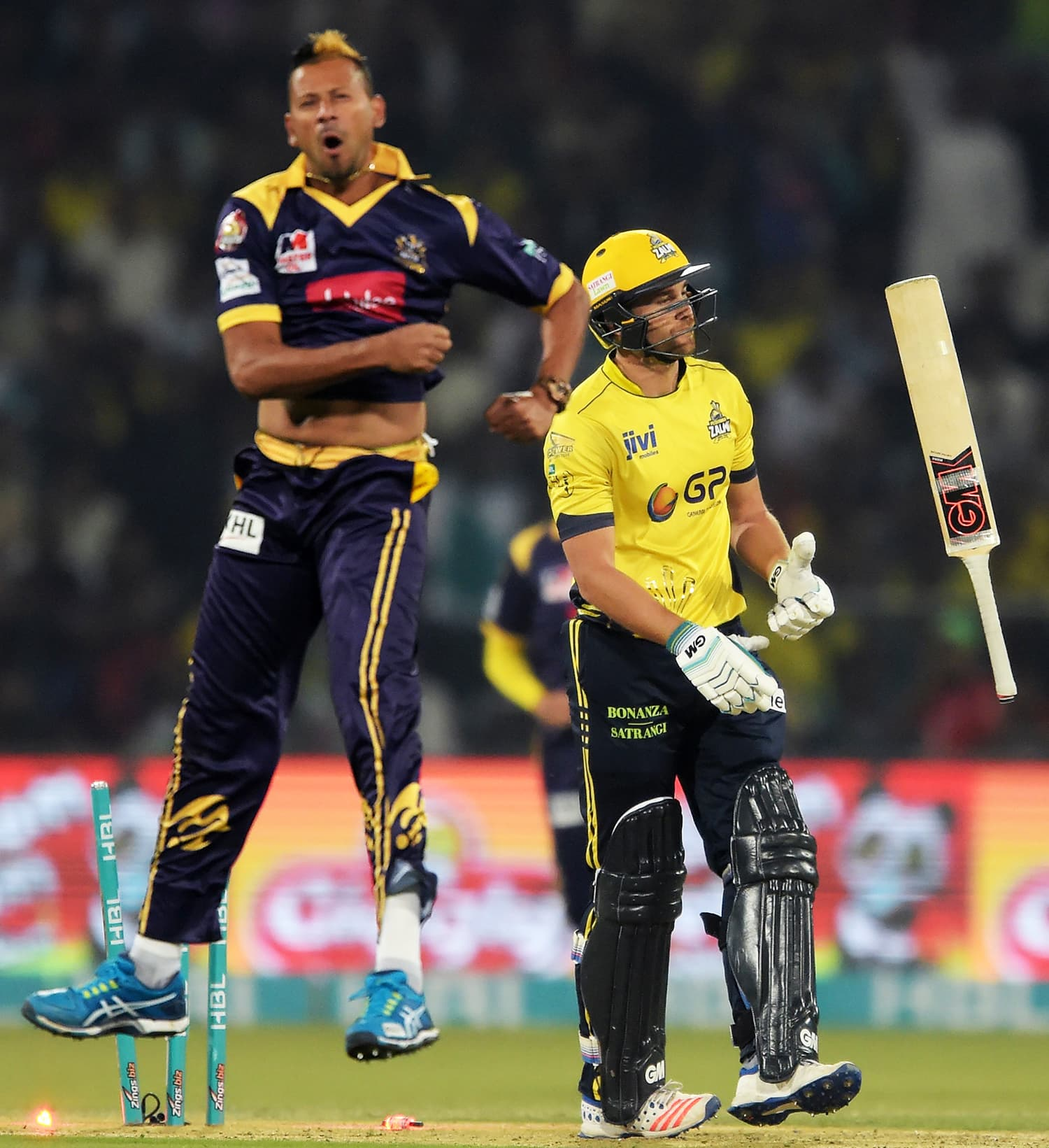 Dawid Malan (R) of Peshawar Zalmi reacts after his dismissal by Quetta Gladiators bowler Rayad Emrit (L). ─ AFP