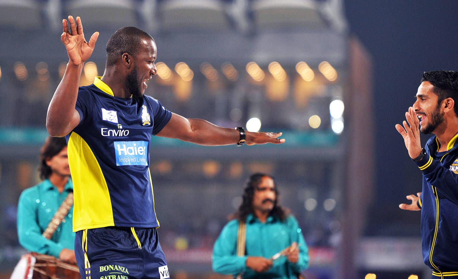 Peshawar Zalmi captain West Indies' Darren Sammy dances with teammates on a stage prior to the start of the final. ─ AFP
