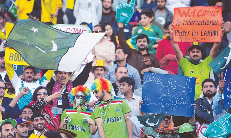 LAHORE: Spectators in a festive mood before the start of the PSL final at Gaddafi Stadium.—AFP