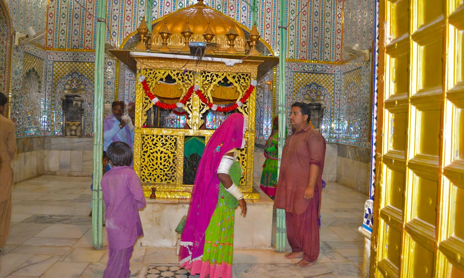 People offering their respects at the Udero Lal Dargah.