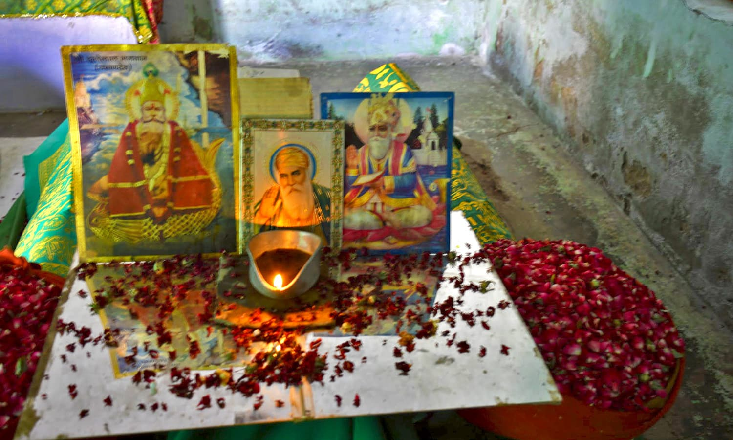 A candle is lit inside a room near the shrine.