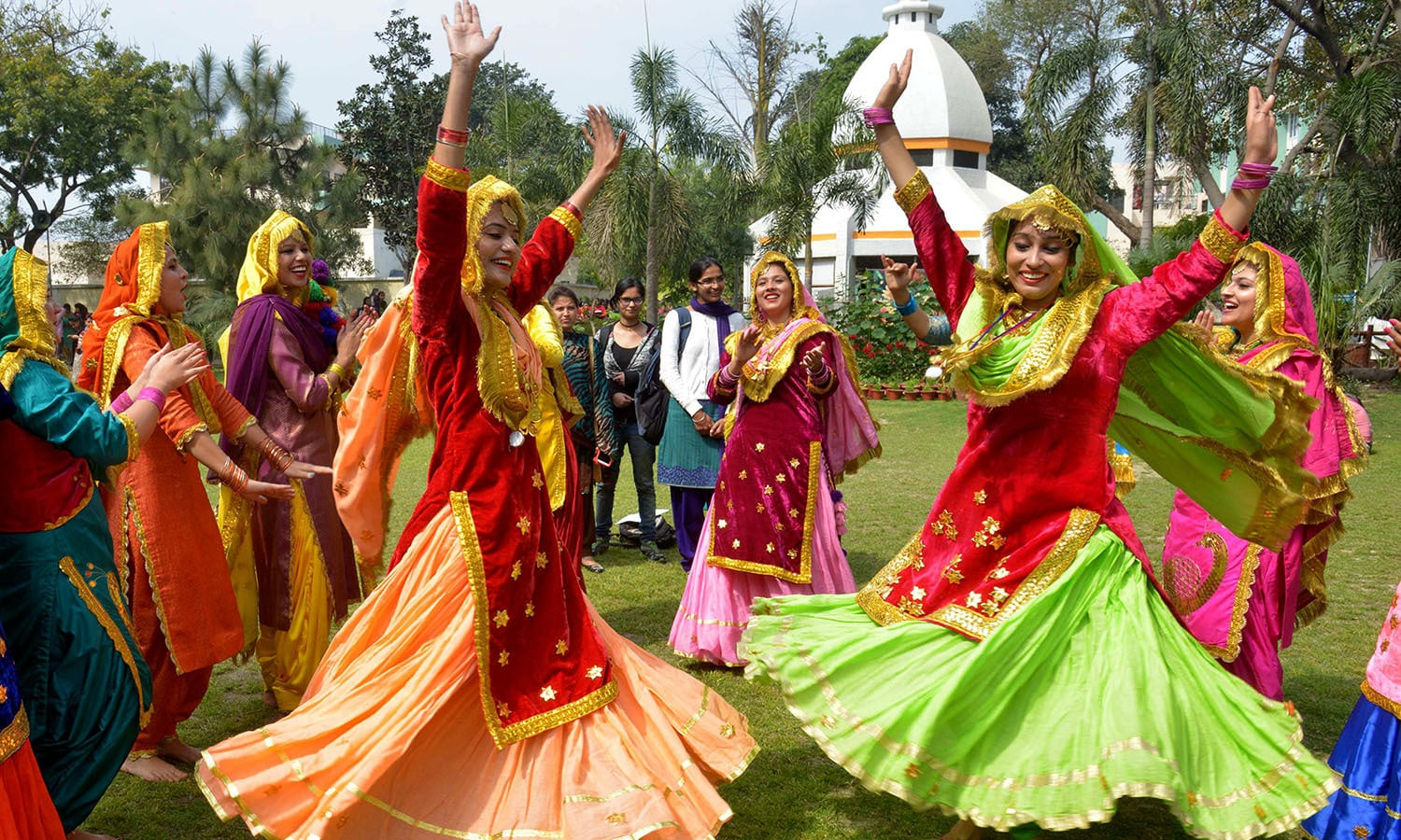 Young Indian women wear traditional Punjabi dress as they perform the 'Giddha' dance during celebrations on the occasion of an International Women's Day function in Amritsar.─AFP