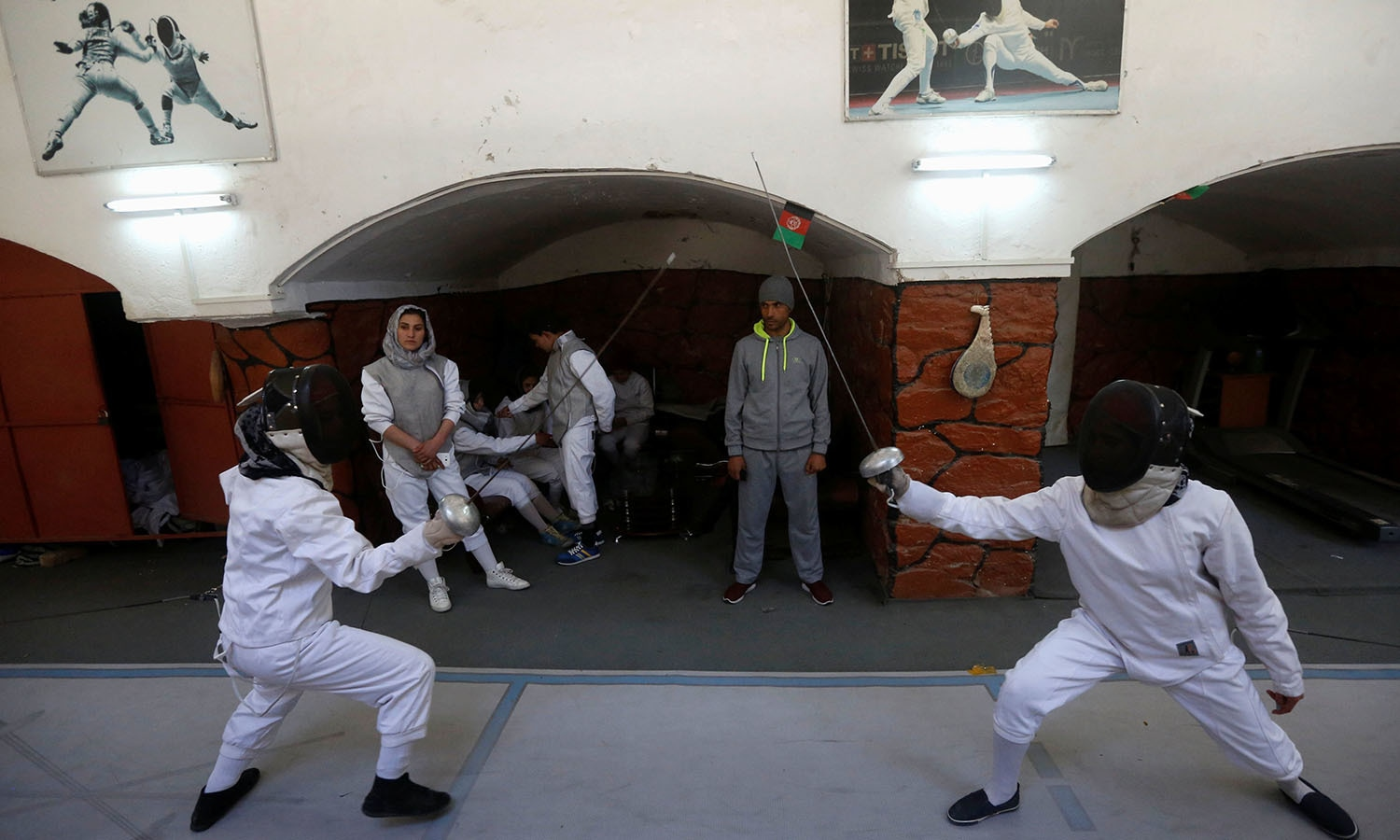 Afghan girls practice their daily training at a fencing club in Kabul, Afghanistan. ─Reuters