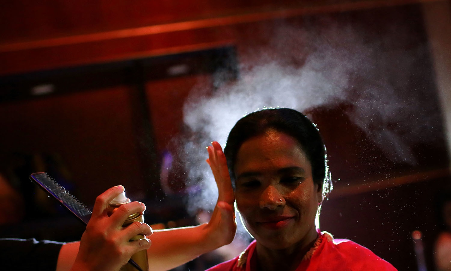 A Bangladeshi acid attack survivor gets her make up applied during the event 'Beauty Redefined' in Dhaka, Bangladesh.─AP