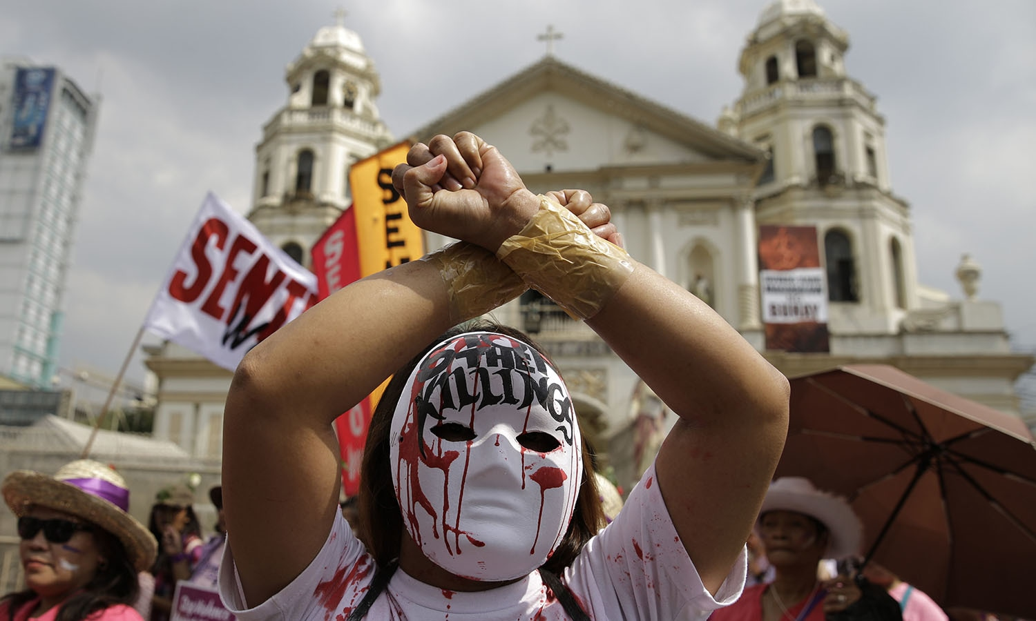 A protester wearing a mask joins a rally as they mark International Women's Day in Manila, Philippines.─AP
