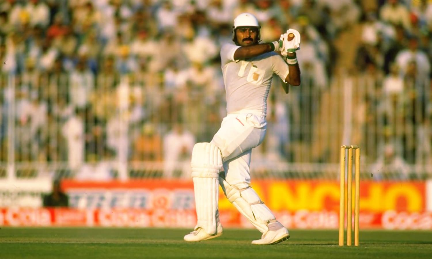 A packed house watch's Pakistan vice-captain Javed Miandad try to pull his team out of trouble against Australia during the 1987 World Cup semi-final at Gaddafi Stadium. — Photo courtesy NDTV Sports