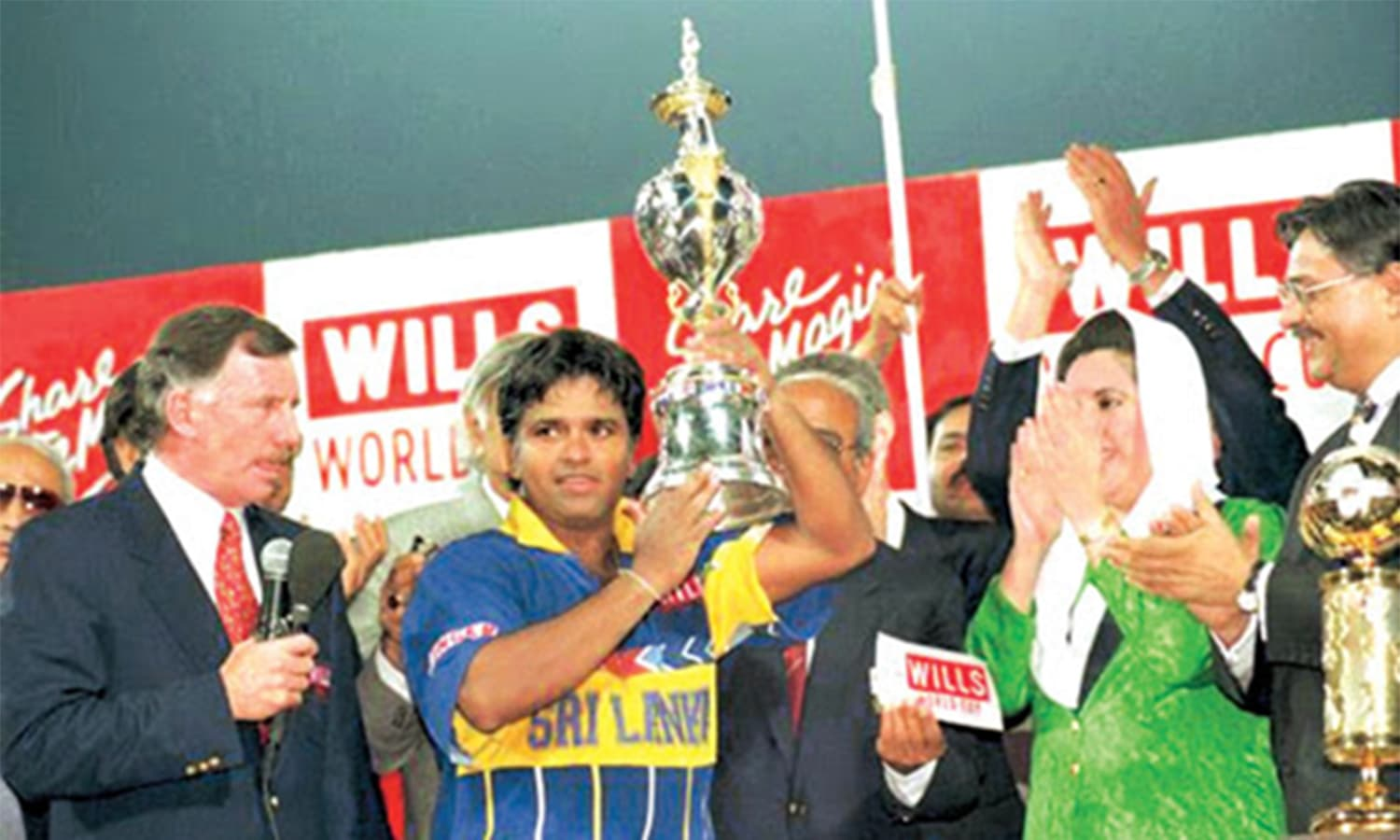 Pakistan PM Benazir handing the 1996 World Cup trophy to Sri Lankan captain at Gaddafi Stadium. Former Australian captain and famous commentator, Ian Chappelle can also be seen (left). (Pic: The News)