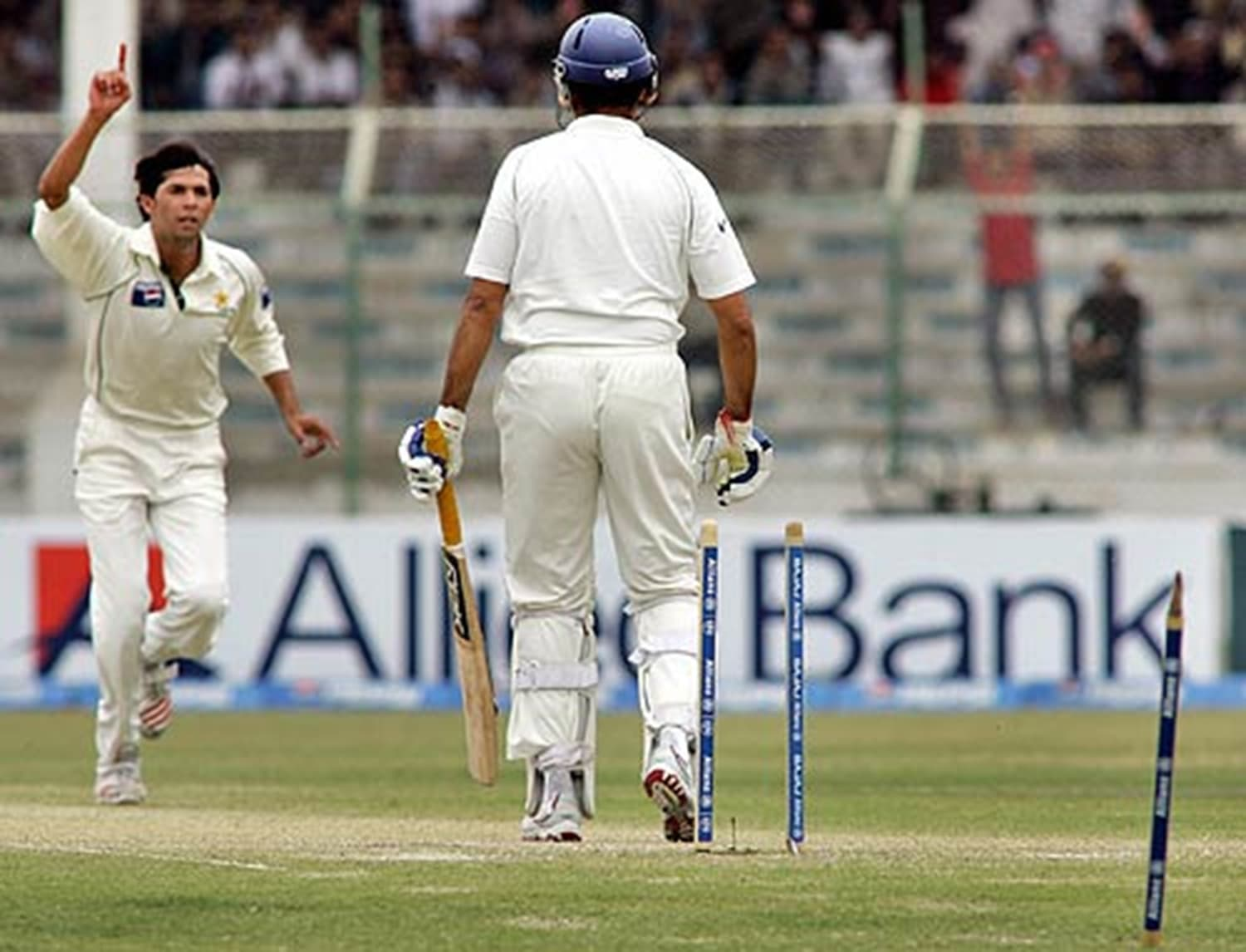 2006: Muhammad Asif cleans up another Indian batsman at the National Stadium as Pakistan nears victory. Fast bowlers have always enjoyed conditions in Karachi where sea-breeze often facilitates swing bowling. (Pic: Faisal Khalid)