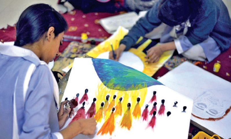(L-R) Renowned dancer Sheema Kirmani, Lok Virsa Executive Director Dr Fauzia Saeed, poet Kishwar Naheed , HRCP's Nasreen Azhar and Pakistan Hindu Council representative Mangla Sharma at the national conference on Wednesday. The other picture is of students participating in a painting competition at the Rawalpindi Arts Council. — Photos by Tanveer Shahzad & APP