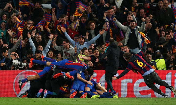 Barcelona's Sergi Roberto celebrates scoring their sixth goal with team mates and fans.—Reuters