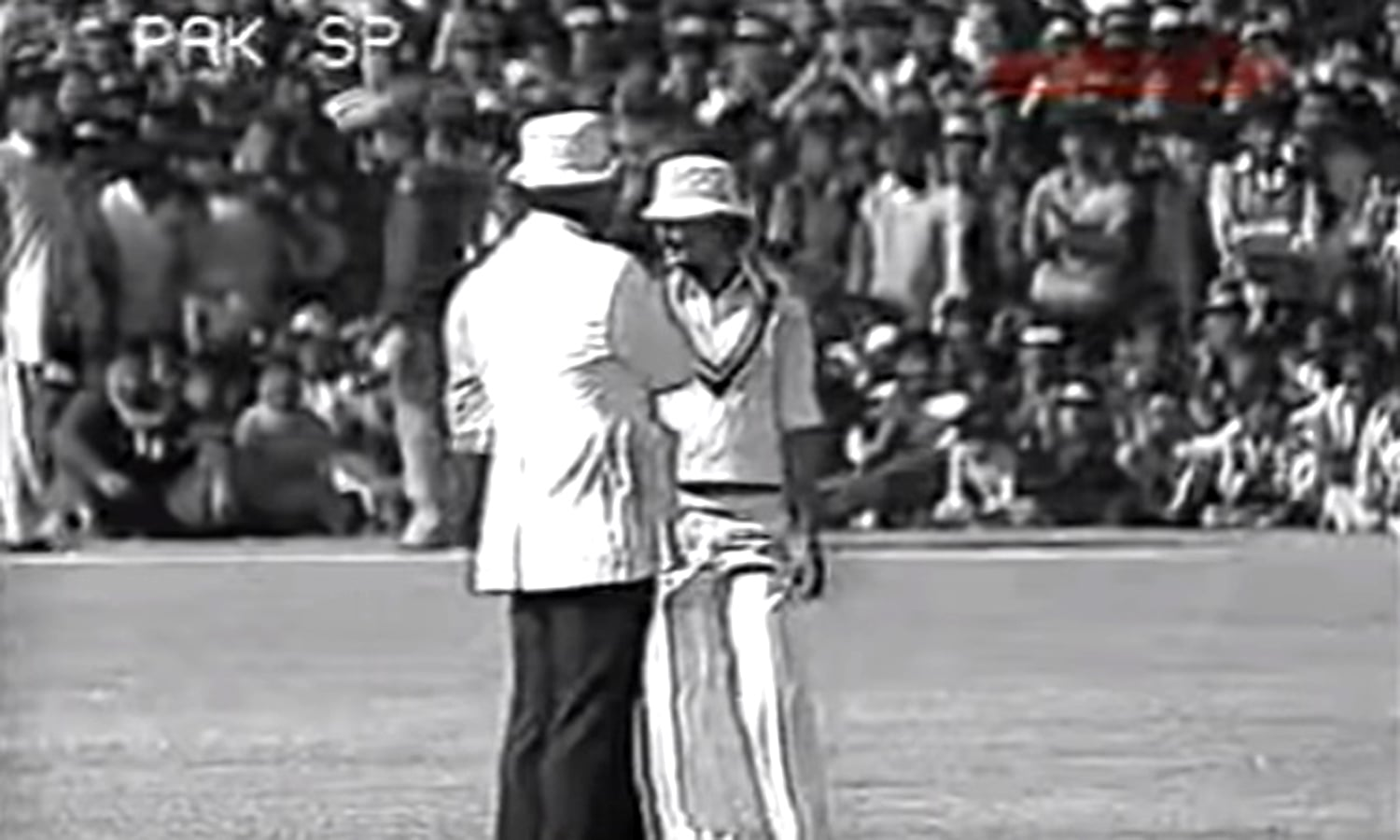 1976: Screen-grab of a New Zealand fielder talking to the leg umpire during the 1976 Pakistan-New Zealand ODI at Jinnah Stadium, Sialkot. The ground at the time had no fencing.