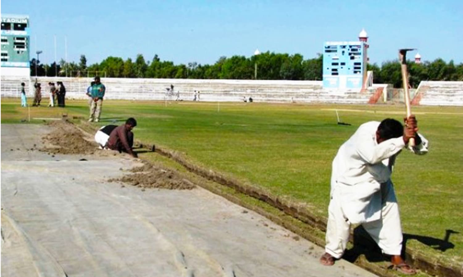 2011: Workers relaying the pitch at Niaz Stadium. (Pic: PPI)