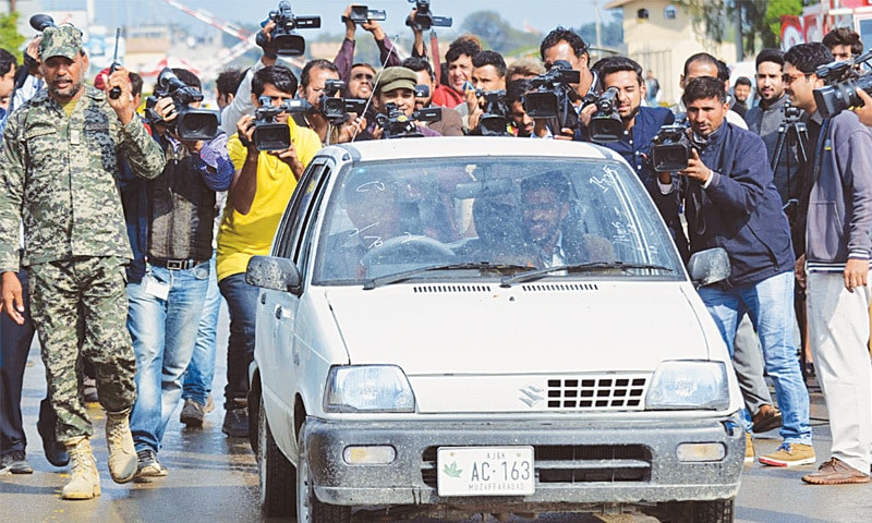 LAHORE: Television crew at the Wagah border on Friday train their cameras on the car carrying Faisal Awan and Ahsan Khursheed, the Pakistani students released by India.—Online