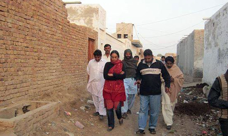 Walking through the streets of Orangi: Perween believed that everyone, regardless of income, had a right to basic services. — Photo courtesy OPP
