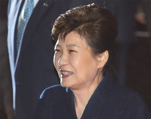 Seoul: Ousted South Korean president Park Geun-hye smiles as she is greeted by supporters upon arrival at her home.—AP
