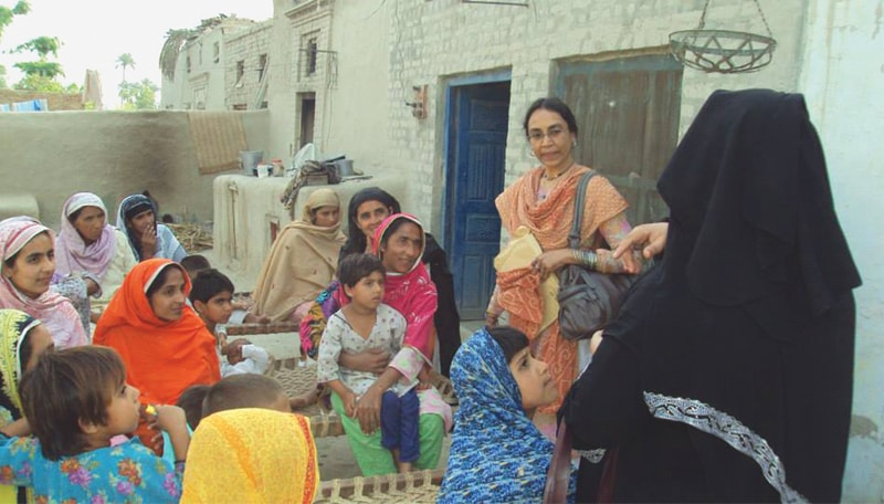Perween enjoyed a personal rapport with the women who are the focus of the savings groups programme run by OPP and its partners in Sindh and Punjab. —Photos courtesy OPP