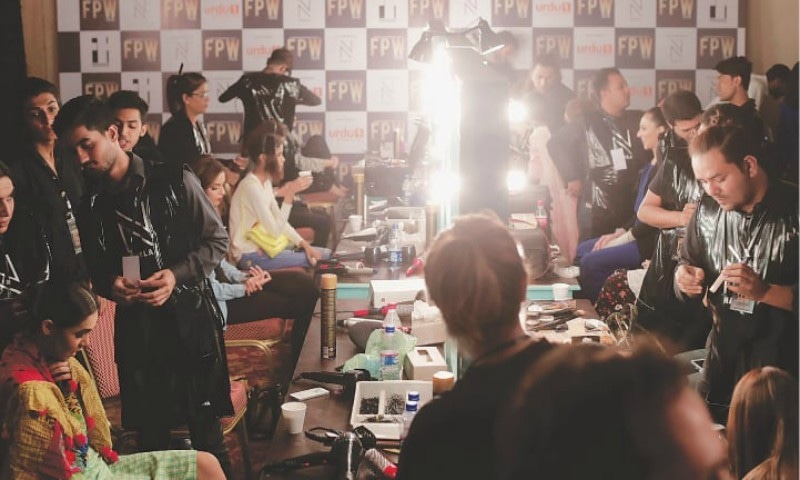 Nabila's hair and make-up team at work backstage