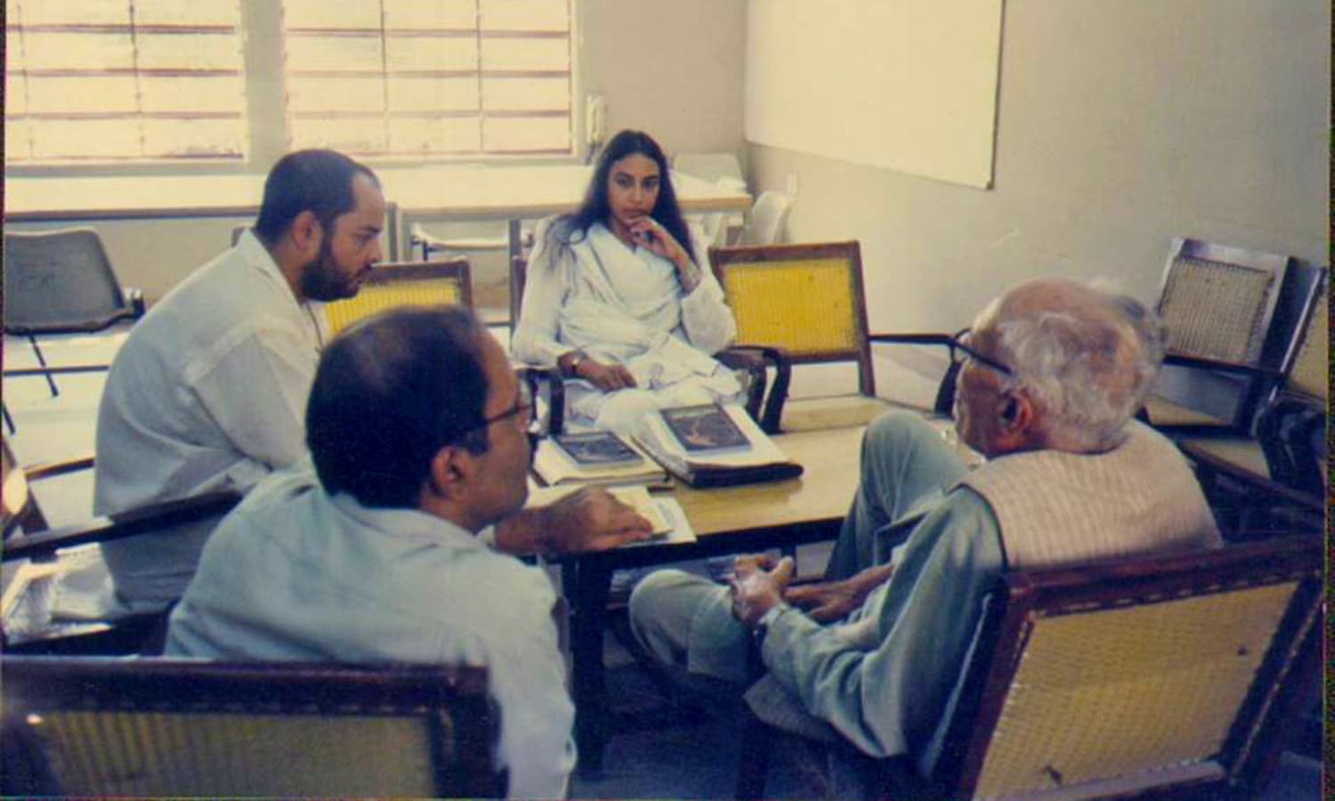 Perween in a meeting at her office. Photo credit: Justice for Perween Rahman