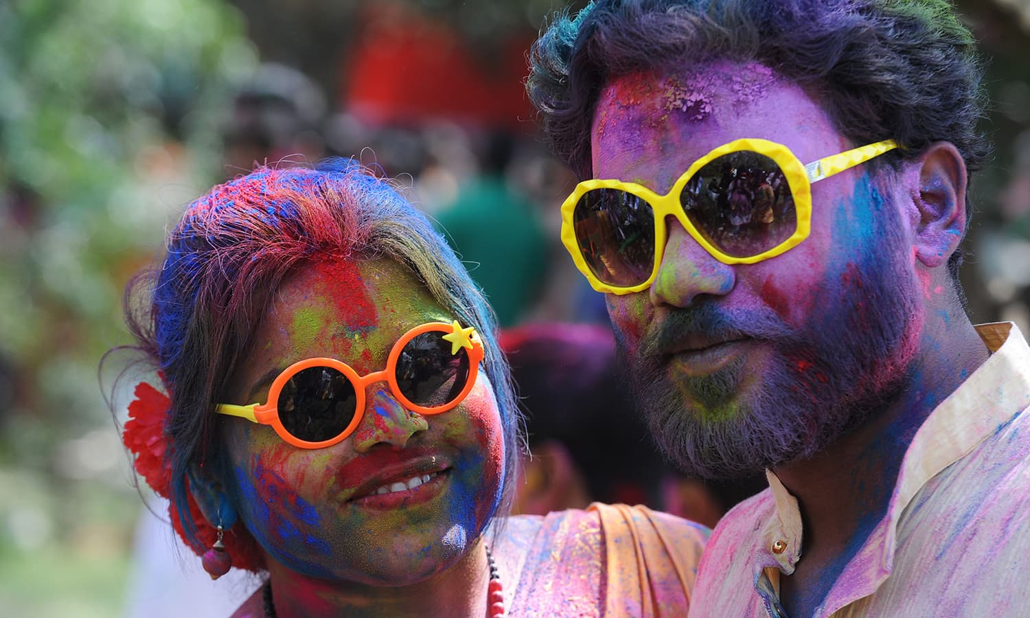Indian revellers play with colours during celebrations for the Holi festival in Siliguri.— AFP