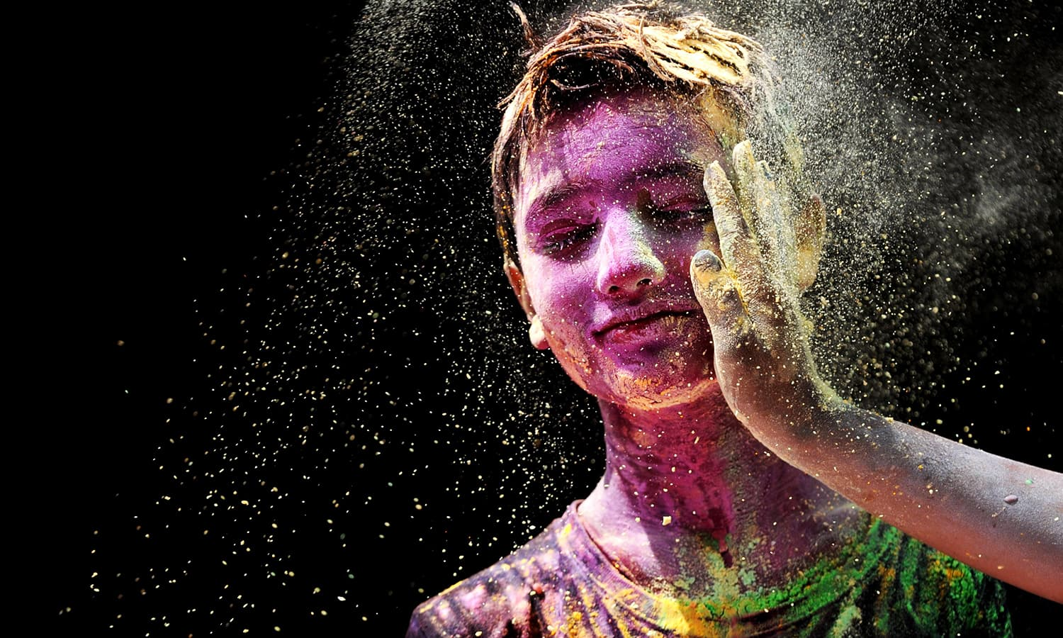 Indian youth play with colours during Holi celebrations in Chennai.— AFP