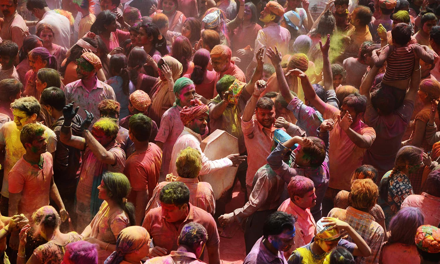 Indian Hindu devotees take part in celebrations for the Holi festival at a Temple in Siliguri on March 13. — AFP