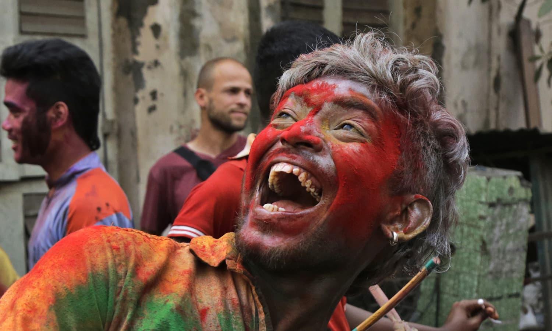 Indians dance on street and celebrate Holi in Kolkata, India.— AP