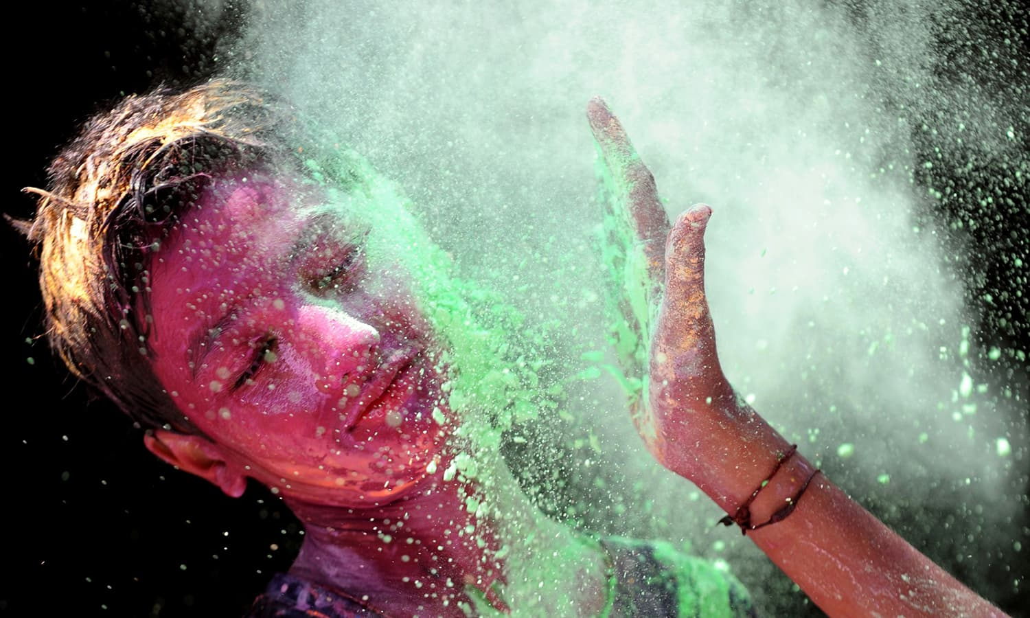 Indian youth play with colours during Holi celebrations in Chennai on March 12.— AFP