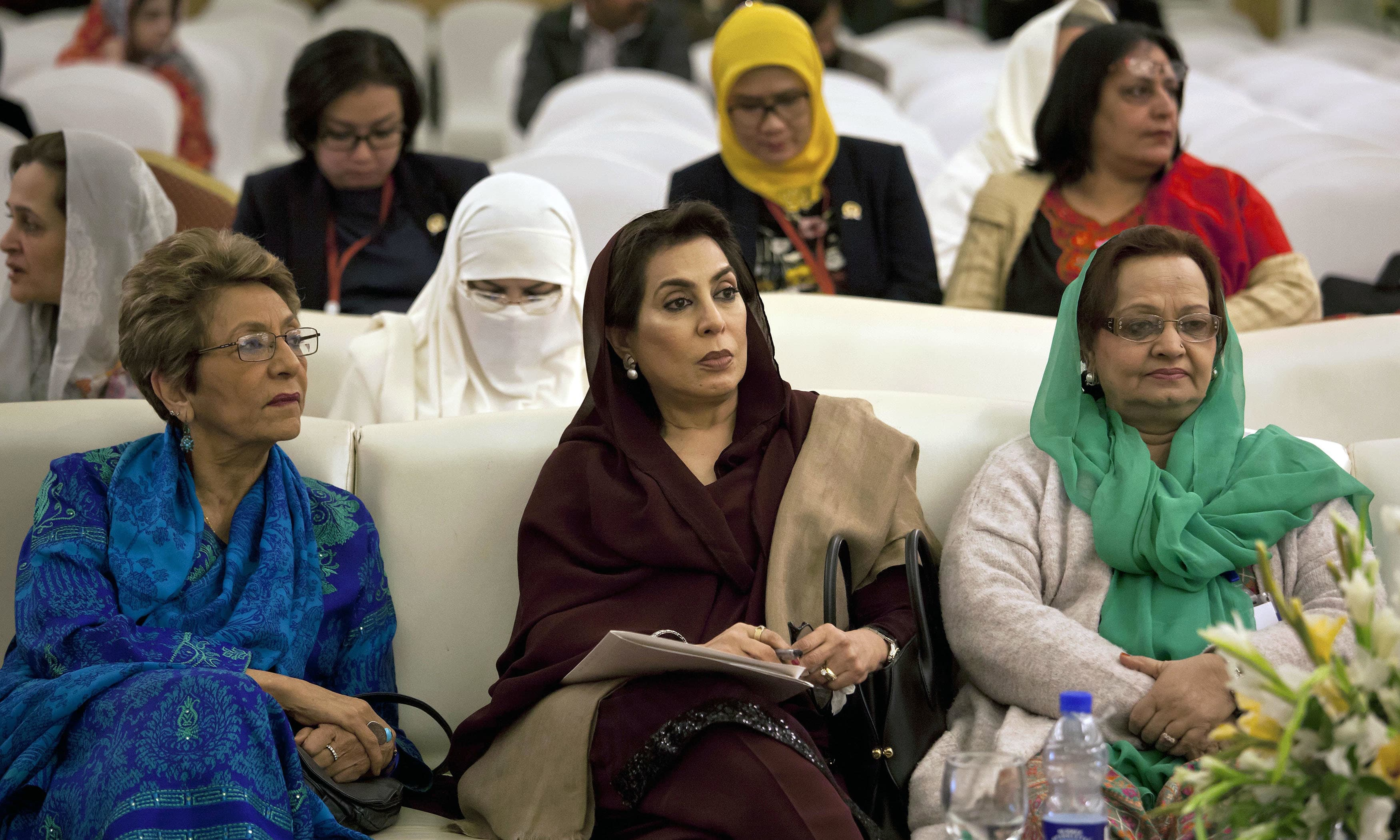 Women lawmakers Tahira Aurangzeb, Fahmida Mirza and other women attend an international women's conference in Islamabad. —AP