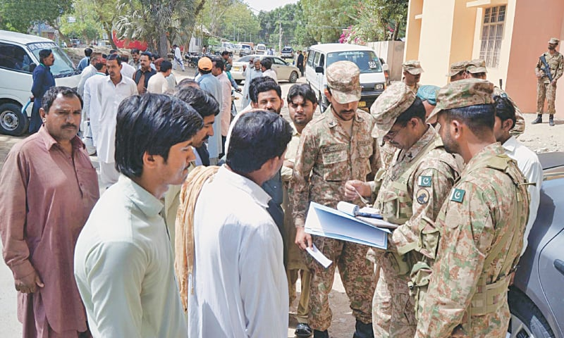 HYDERABAD: Army personnel examine the documents of the field staff at the assistant commissioner's office on Tuesday.—INP