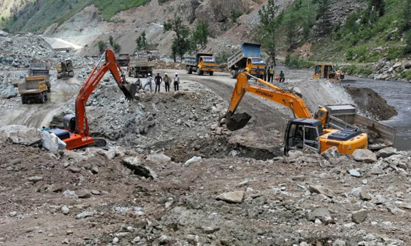 Excavators are used to dig earth at the dam site of Kishanganga power project in Gurez, 160 km (99 miles) north of Srinagar. — Reuters