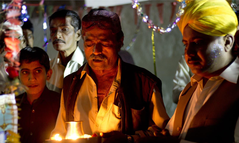 Maharaj does Arti Pooja.