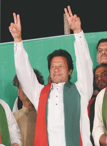 Imran Khan gestures at a PTI rally