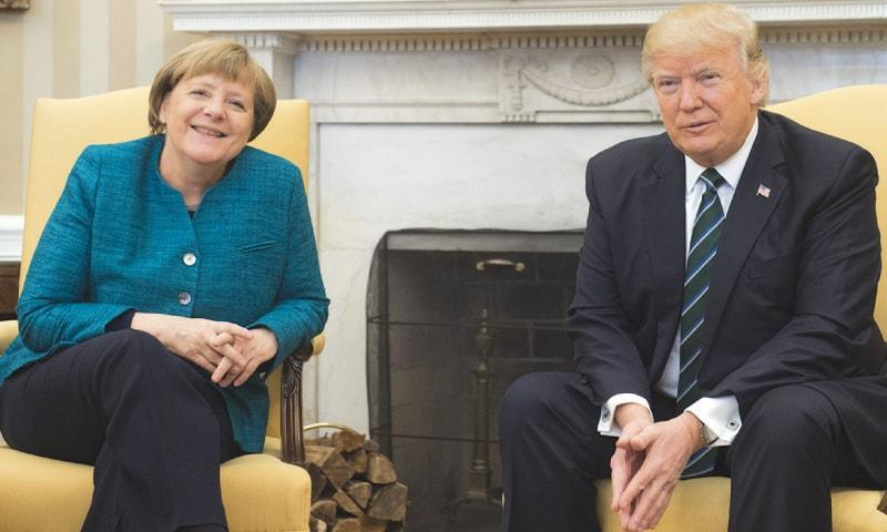 Trump pledges Nato support, presses Merkel on spending