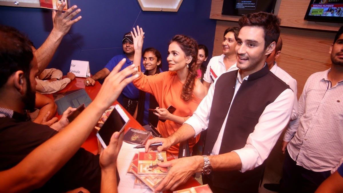Humaima Malick and co-star Sikander Rizvi distributing DMPS OST to fans. Director Asad ul Haq says she did not participate in the film promotions as much as she should have.