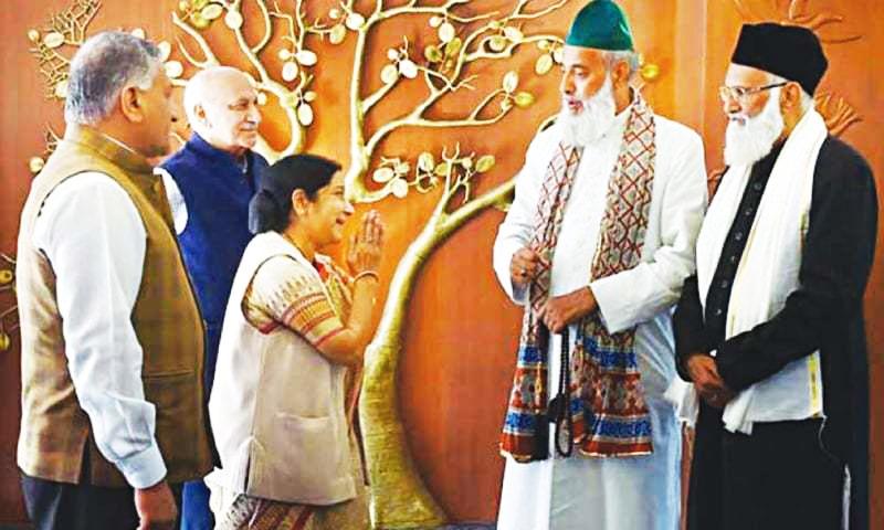 External Affairs Minister Sushma Swaraj meets Syed Asif Ali Nizami (right) and his nephew Nazim Ali Nizami on their return from Pakistan to Delhi on Monday.
