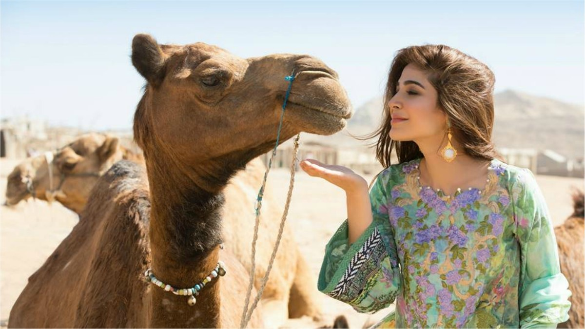 Lawn ads are big on animals it seems (Ayesha Omar poses with her new friend for Crimson x Saira Shakira)