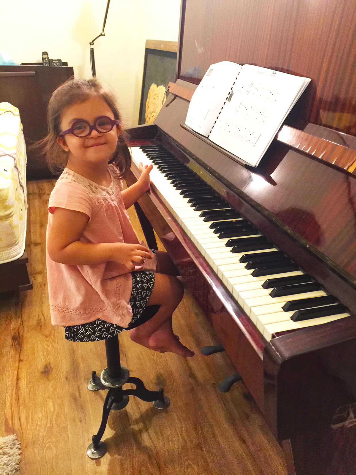 She enjoys so many different activities, one of them being playing the piano.