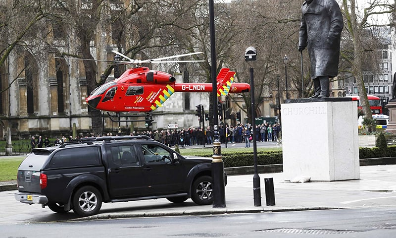 An air ambulance lands in Parliament Square during an incident on Westminster Bridge in London. —Reuters