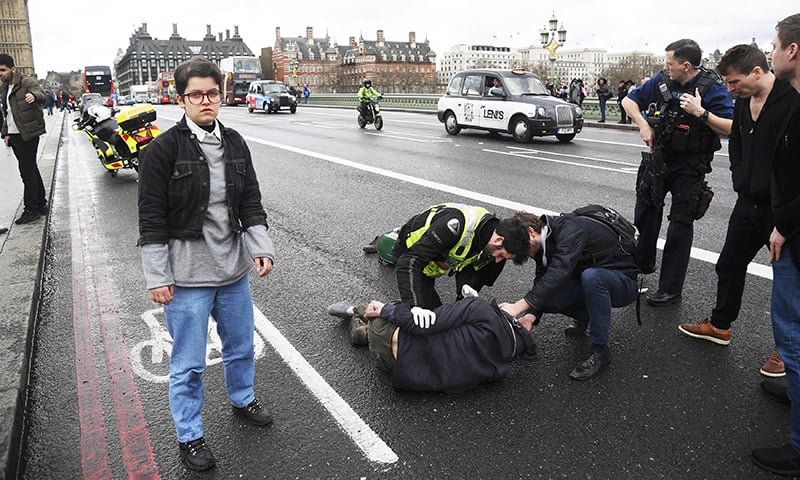 Injured people are assisted after an incident on Westminster Bridge in London. —Reuters