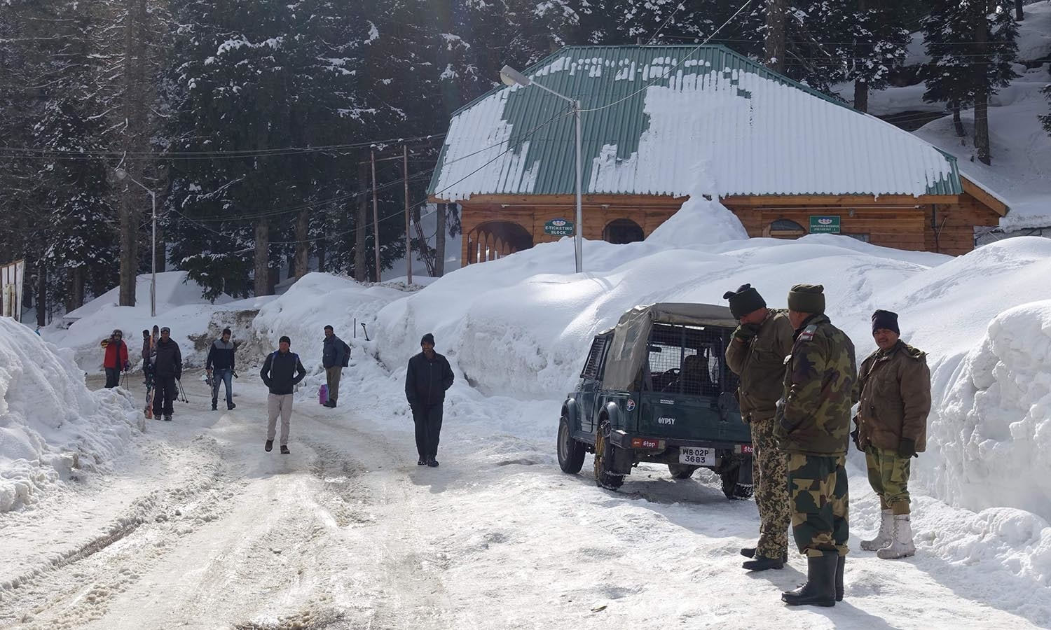 Indian security officials stand near the gondola at Gulmarg in Indian-held Kashmir.─AFP