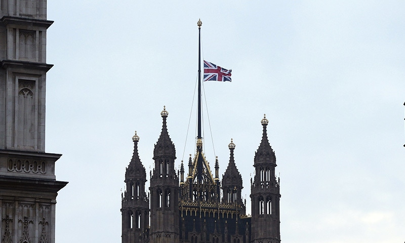 The flag above the Houses of Parliament flies at half mast,  the day after a terrorist attack in London. ─ AP