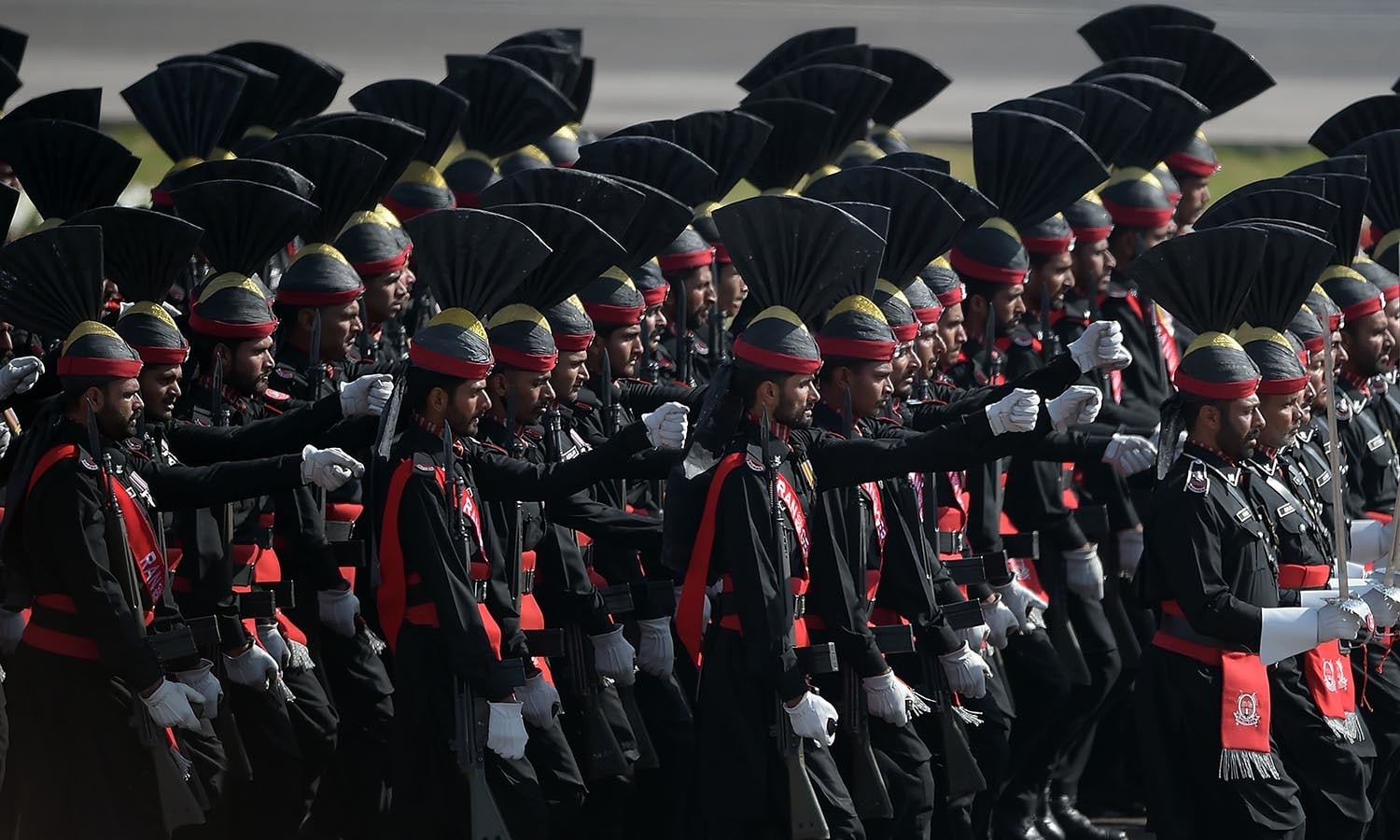 Pakistani border soldiers march past during a Pakistan Day military parade.─AFP