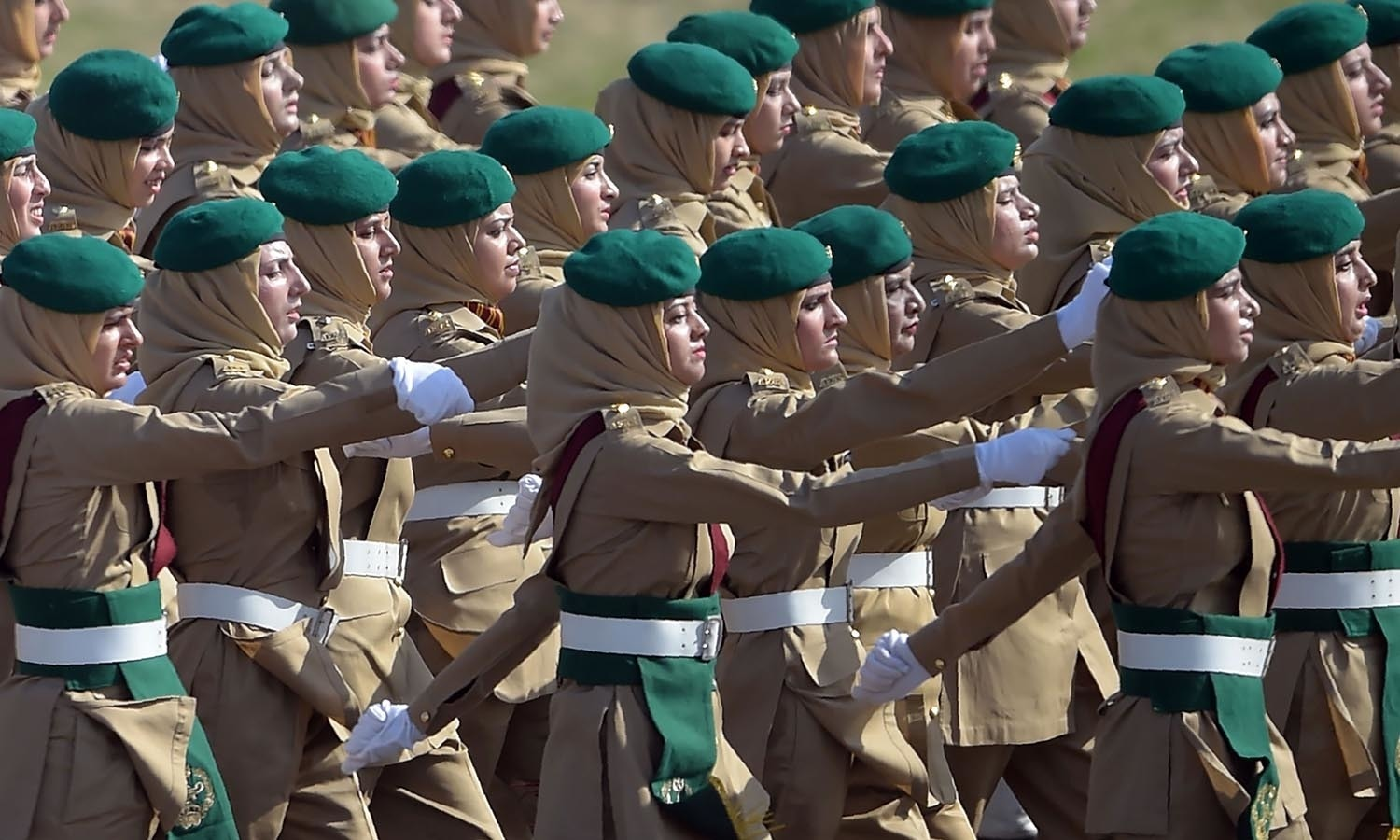 Female Pakistani army soldiers march past during a Pakistan Day military parade.─AFP