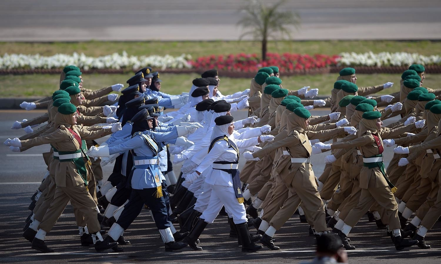Female soldiers of Pakistan's Air Force, Navy and Army march past during a Pakistan Day military parade.─AFP
