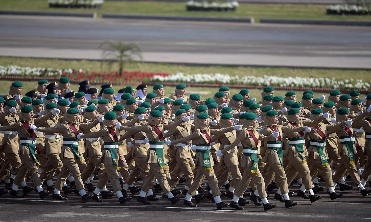 Pakistani women army soldiers march past during a Pakistan Day military parade.─AFP