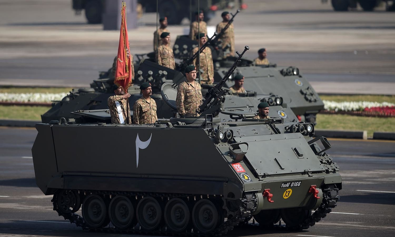 Pakistan's tank crews steer their vehicles during a Pakistan Day military parade.─AFP