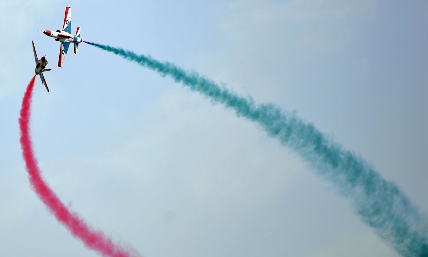 Pakistani jets perform aerobatic manoeuvres during a Pakistan Day military parade.─AFP
