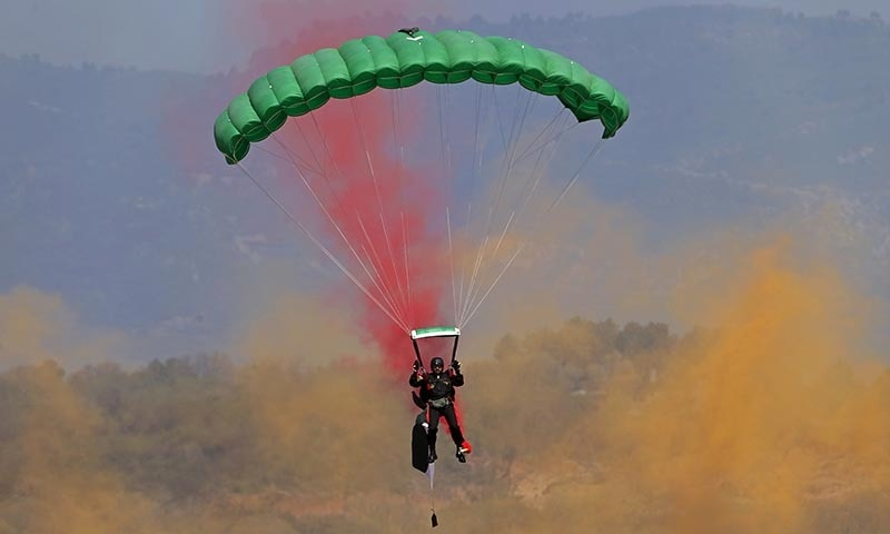 A Pakistan army paratrooper performs during a military parade to mark Pakistan's Republic Day.─AP