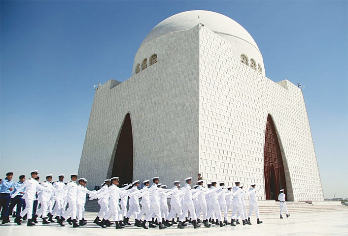NAVAL cadets parade in front of the Quaid's mausoleum on Thursday.—PPI